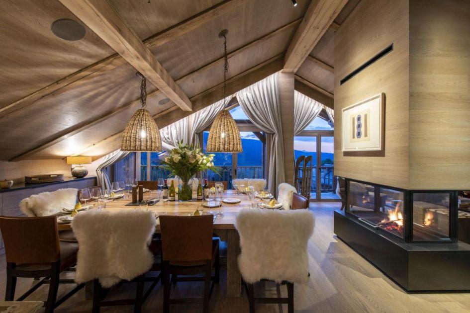 Chalet-la-loze-open-fire-dining-table